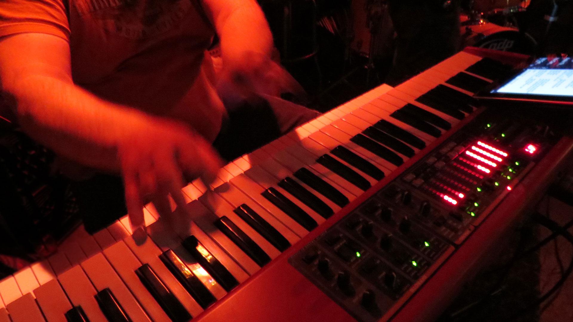 Image: Mark Bentley, hands on keyboard, blurred, red lighting (1920x1080px)